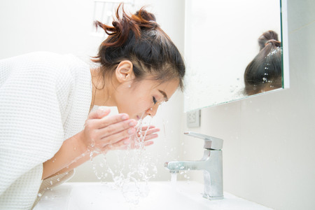 Woman wakes from sleep and she was cleansing the morning before shower Reklamní fotografie - 85942196