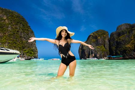 Tourist woman enjoying at Koh Phi Phi, Maya Bay in the summer of Thailand