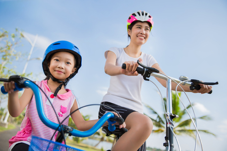 Mother and daughter are cycling exercise