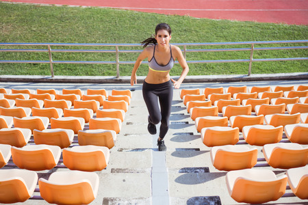 Asian women run up the stairs. It is out of strength and cardio.