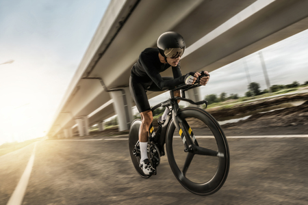 """Asian men are cycling """"time trial bike"""" in the morning Reklamní fotografie"""