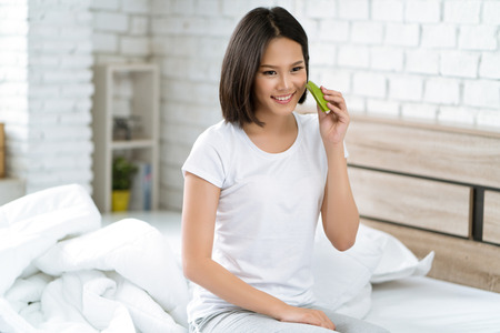 Asian women are using Aloe Vera on her face Before she sleep Stock Photo