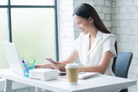 Asian woman  working happily