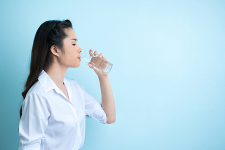 Asian women working outfits are drinking water