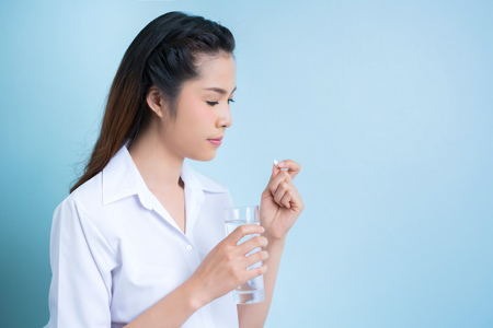 Asian women are taking a medicine