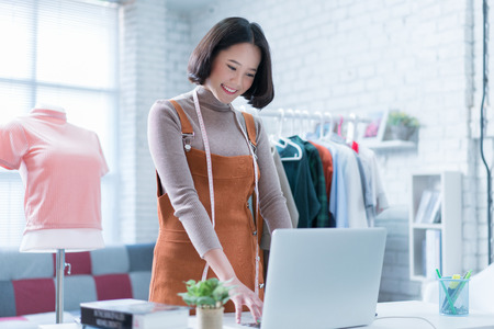 Online sales are answering customers' questions through their laptops, doing business in her home.