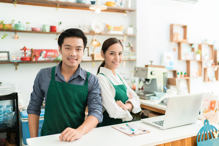 Asian barista is making coffee at his restaurant. And own a coffee shop Stock Photo