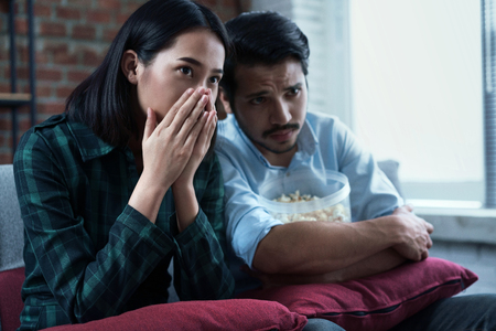 Couples are watching movies at home Stock Photo