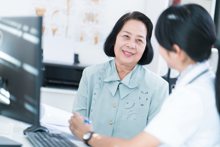 Doctors are checking the history of elderly patients that have a disease.