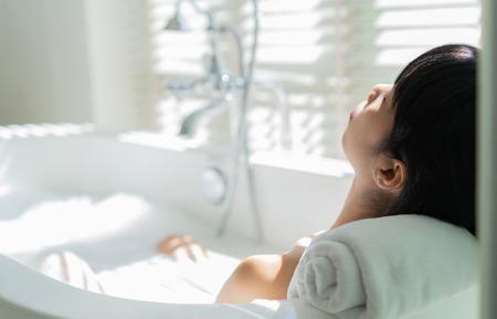 Woman relaxing in bathtub Stock Photo