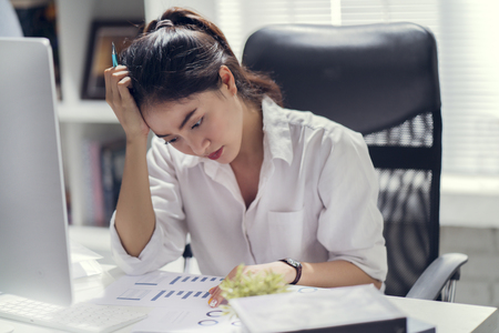 Business woman stress from work she is at the office. Stock Photo