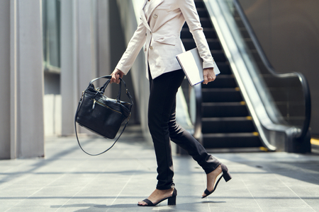 Business woman walking to the office. Stock Photo