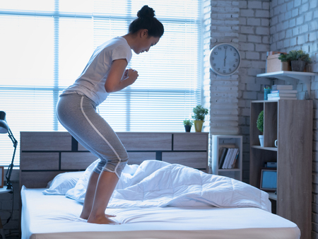 Asian woman exercising in bed in the morning, she feels refreshed. Banco de Imagens - 120465583
