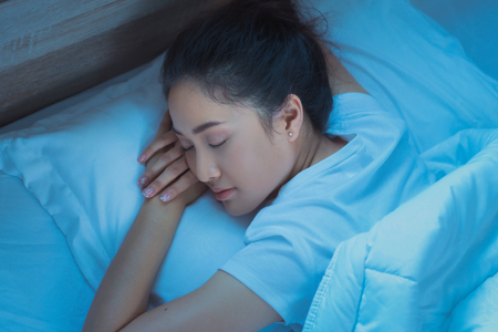 Asian woman  sleeping  tightly on bed