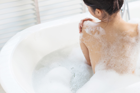 Woman  bathing in a   bathtub Banque d'images