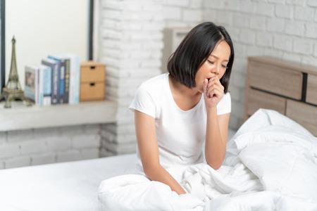 Asian woman yawning during her wake