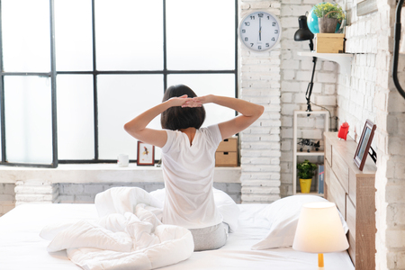 Asian woman   waking up in the morning. She felt very refreshed. Stock Photo