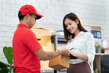 business woman receiving a parcel