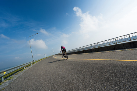 Asian man cycling road bike in the morning