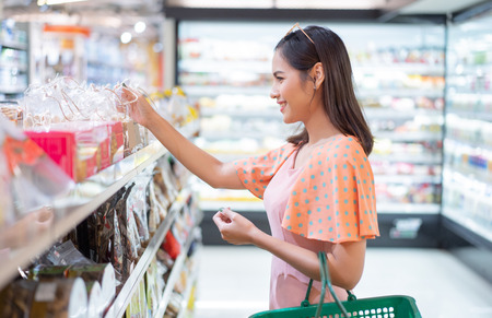 The woman is in the supermarket  shopping for food Stock Photo