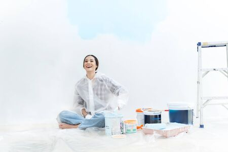 Asian woman  painting the house