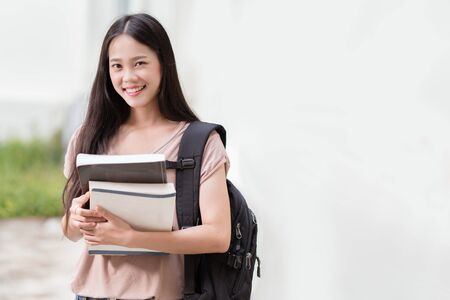 Concept of asian student  holds  textbook. Stock Photo