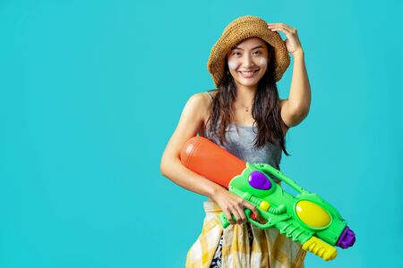 Asian people are using water guns Play in Songkran Festival She applied the powder on the face. The studio concept