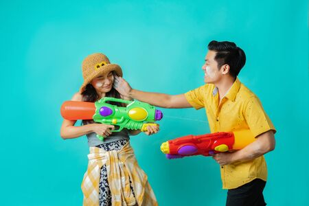 Asian people are using water guns Play in Songkran Festival They put the powder. Concept in the studio