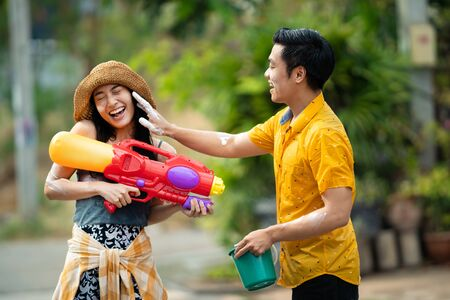 Asian people are using water guns play in the Songkran festival
