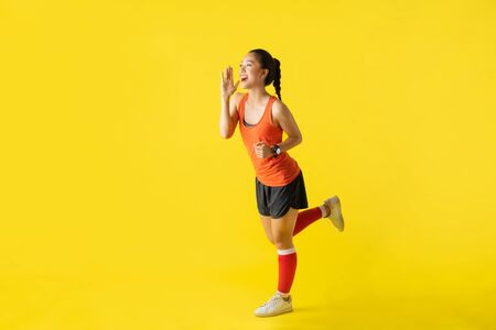 Runner asian woman announcer news on yellow background about race