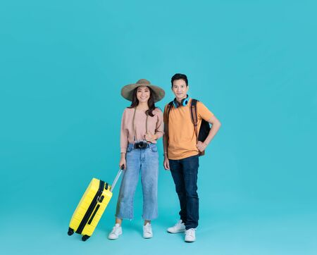 Asian tourist couple They are excited. to go to travel