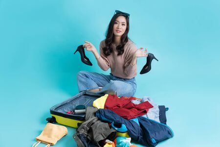 Asian woman preparing luggage for tourism she felt confused and in a hurry. Stock Photo
