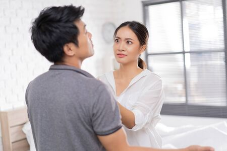 Asian lovers, they are arguing . woman with stress