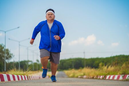 Asian men are jogging to lose weight Stock Photo