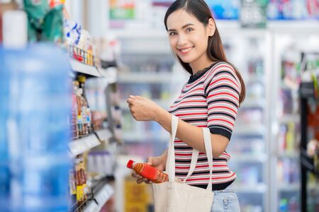 Asian woman used a cloth bag to buy things without a plastic bag.