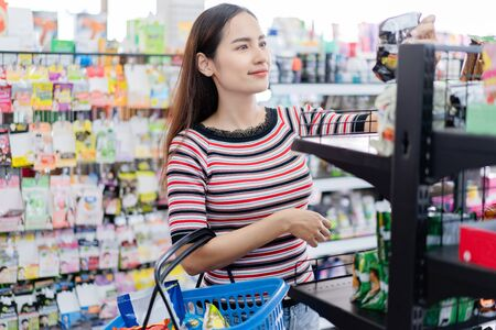 Asian woman shop in supermarket