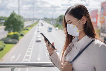Asian woman are going to work.she wears N95 mask.prevent PM2.5 dust and smog She shares the power of dust in a social network.