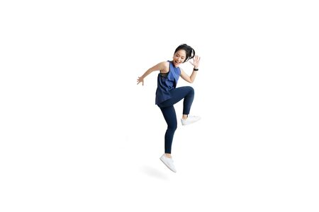 Asian woman is jumping and exercising 스톡 콘텐츠