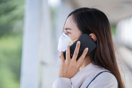Asian woman are to work.she wears N95 mask.prevent PM2.5 dust and smog