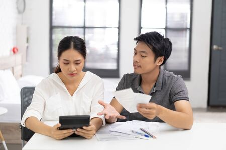 Asian couples are stressed with Bill payment Stock fotó