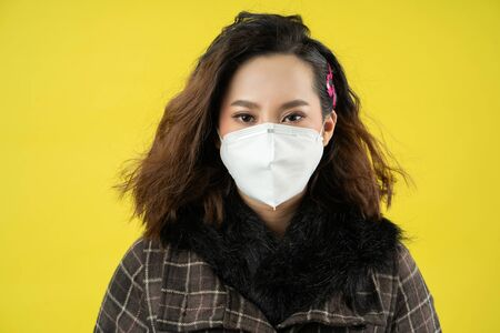 Asian woman she wears N95 mask.Prevent PM2.5 dust and smog studio concept