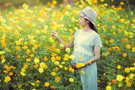 Pregnant woman are happy In the flower garden Stock fotó