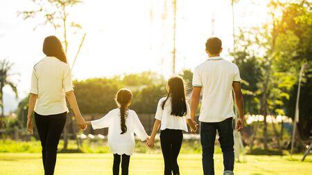 Happy family walking in the garden at home Stock fotó