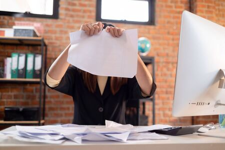 Asian business woman tore off the paper. Stock fotó