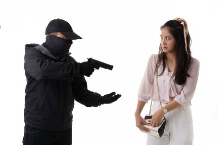 Thief use a gun to threaten a woman. He needs money