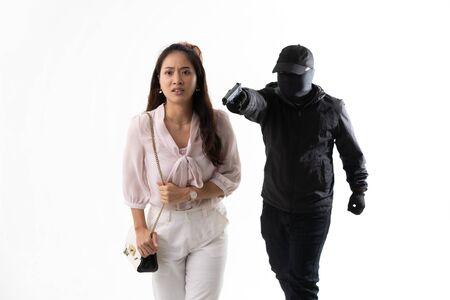 Robber use a gun to threaten asian woman .He needs money in her pocket but she runs away.