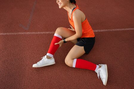 Asian woman runners she was injured by running.