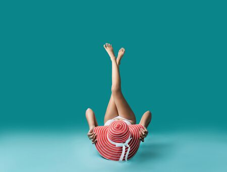 Beautiful asian woman wearing bikini in sunbathing in a studio