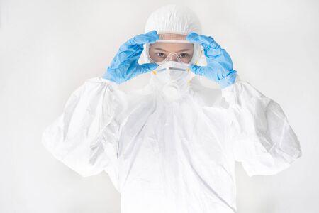 female virologist, she wears PPE. Stock Photo