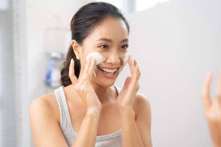 Beautiful female asian Wash face in bathroom